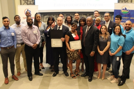 The first graduates of Mayor Turner's Turnaround Houston Entrepreneurship Program celebrate their completion of a five-week class designed for previously incarcerated individuals interested in starting their own business.